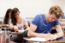 Three high school students taking a test